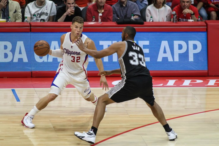 Blake Griffin tries to shake off the Spurs' Boris Diaw in Game 7 of the NBA Western Conference first round series. Photo Credit: Jevone Moore/News4usonline.com