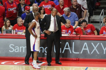Chris Paul confering with Clippers coach Doc Rivers. Photo Credit: Jevone Moore/News4usonline.com