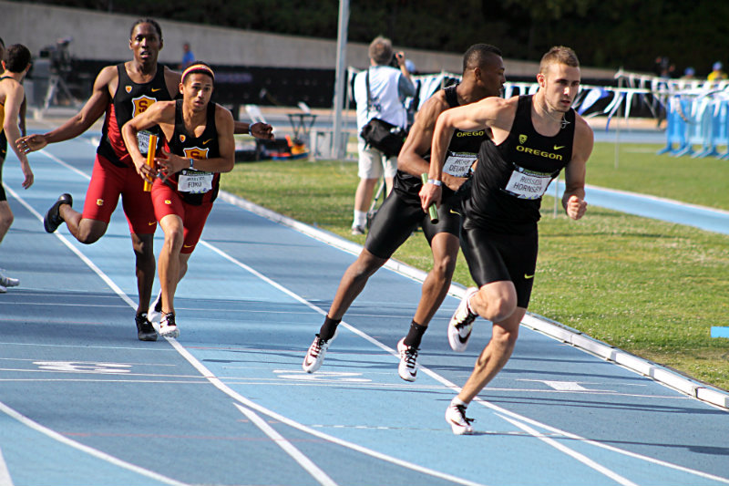 Oregon's Russell Hornsby takes the handoff from Arthur Delaney in the men's 4x400 relay on the final day of the 2015 Pac-12 Track and Field Championships. Oregon would win the race in a time of 3: 05. 84. Photo Credit: Dennis J. Freeman/News4usonline.com