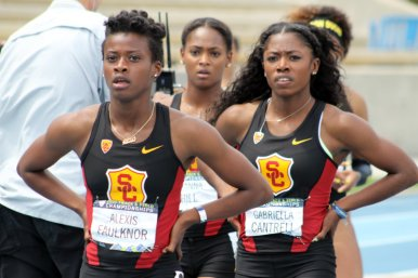 USC teammates look up at the relay of the women's 100 meters, which was won by Oregon's Jasmine Todd. Photo by Dennis J. Freeman/News4usonline.com