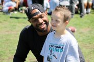 Jacksonville Jaguars tight end Marcedes Lewis with a friend at the Marcedes Lewis 7th Annual Football Camp Saturday, June 20, 2015. Photo by Dennis J. Freeman