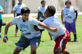 Linemen got after each other pretty good during the 7th Annual Marcedes Lewis Football Camp, which was held at Long Beach Poly High School in Long Beach, California. More 800 youths participated in the camp on Saturday, June 20, 2015. Photo by Dennis J. Freeman/News4usonline.com