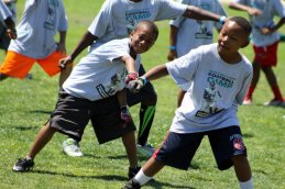 These campers attending the 7th Annual Marcedes Lewis Football Camp break into a dance routine at Long Beach Poly High School, Saturday, June 20, 2015. Photo by Dennis J. Freeman/News4usonline.com