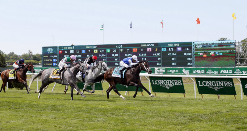 Julien R. Leparoux races across the finish line on Tepin to win the Longines Just a Game race at the 147th Belmont Stakes at Belmont Park Race Track, on Saturday, June 6, 2015 in Elmont, N.Y. (Photo by Stuart Ramson/Invision for Longines/AP Images)