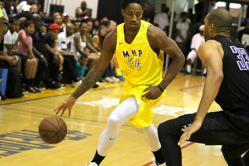 Compton native DeMar DeRozan (Toronto Raptors) tries to get to the basket for  the Most Hated Players in the championship game at the Drew League. Photo by Dennis J. Freeman