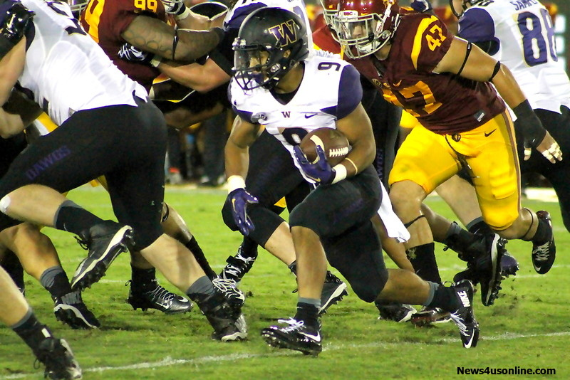 Washington running back Myles Gaskins had a big night for the Huskies against the USC Trojans on Thursday, Oct. 8, 2015. Gaskins rushed for 134 yards and scored a touchdown in Washington's 17-12 upset win over the Trojans. Photo by Dennis J. Freeman/News4usonline.com