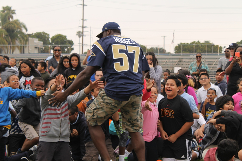 Rams linebacker Zack Hodges (57) feels the community vibe as mingles with students from the Inglewood Unified School District. Photo by Dennis J. Freeman/News4usonline.com