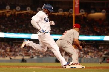 Carl Crawford hits first base. Photo by Astrud Reed/News4usonline.com