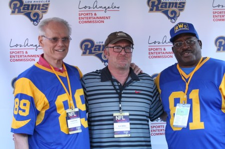 Former LA Rams star and actor Fred Dryer (left) have some fun. Photo by Astrud Reed/News4usonline