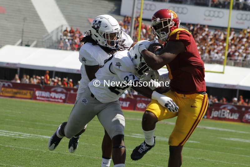USC wide receiver Darreus Rogers moves the chain with this reception against Utah State. Photo by Dennis J. Freeman/News4usonline