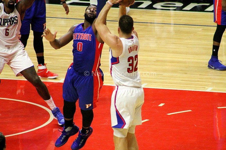 Blake Griffin (32) gets the ball over the outreached hand of Andre Drummond.