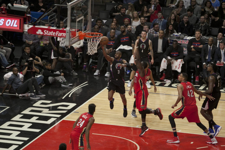 Chris Paul goes for two of his 20 points against the New Orleans Pelicans. Photo by Astrud Reed/News4usonline.com