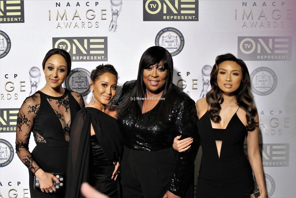 """Cast members from the talk show """"The Real"""" all dressed in black on the red carpet at the 48th Annual NAACP Image Awards on Friday, Feb. 10, 2017. From left to right are Tamera Mowry-Housley, Adrienne Bailon, Loni Love and Jeannie Mai. Photo by Dennis J. Freeman/News4usonline"""
