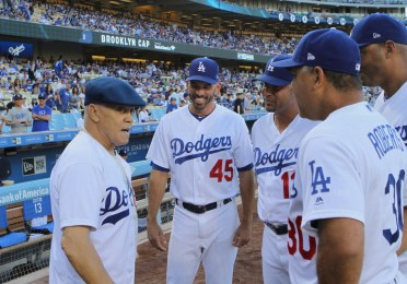 The great Maury Wills is greeted by current Dodgers on Monday, June 19, 2017. Wills, along with Frank Robinson and Don Newcombe was honored during the team's African American Heritage Night celebration. In 1962, Wills stole 104 bases as the National League MVP. Photo by Astrud Reed for News4usonline