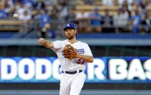 The Los Angeles Dodgers had their celebration of winning five straight NL West Division title muted after their bats went quiet against San Francisco Giants pitcher Madison Bumgarner on Saturday, Sept. 23, 2017. Photo by Kevin Carden/News4usonline