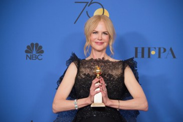 """After winning the category of BEST PERFORMANCE BY AN ACTRESS IN A LIMITED SERIES OR A MOTION PICTURE MADE FOR TELEVISION for her role in """"Big Little Lies,"""" actress Nicole Kidman poses backstage in the press room with her Golden Globe Award at the 75th Annual Golden Globe Awards at the Beverly Hilton in Beverly Hills, CA on Sunday, January 7, 2018."""