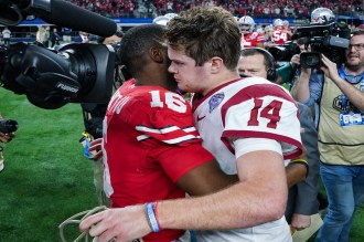 Ohio State's J.T. Barrett (16) and USC quarterback Sam Darnold (14) embrace after the 82nd Annual Cotton Bowl Classic had concluded. Photo by Michael Lark for News4usonline