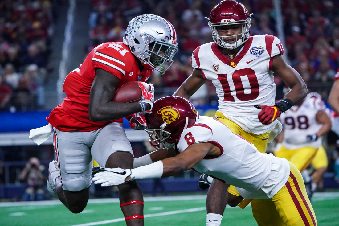 Ohio State running back MIke Weber (25) on the run at the 82nd Annual Goodyear Cotton Bowl Classic. Photo by Michael Lark for News4usonline