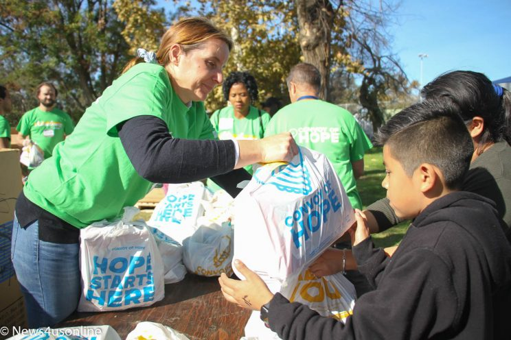 Passing out free groceries