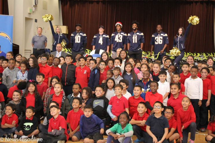 Los Angeles Chargers pass out bikes to students at Cesar Chavez Elementary School in Long Beach, California.