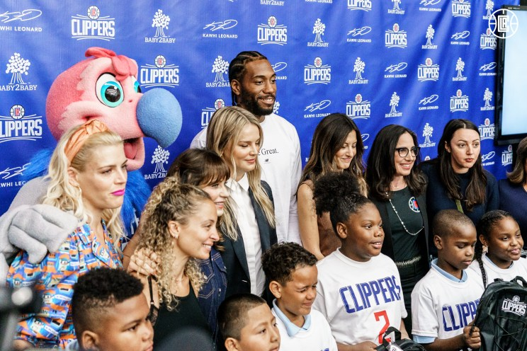 Kawhi Leonard in South Los Angeles giving away backpacks