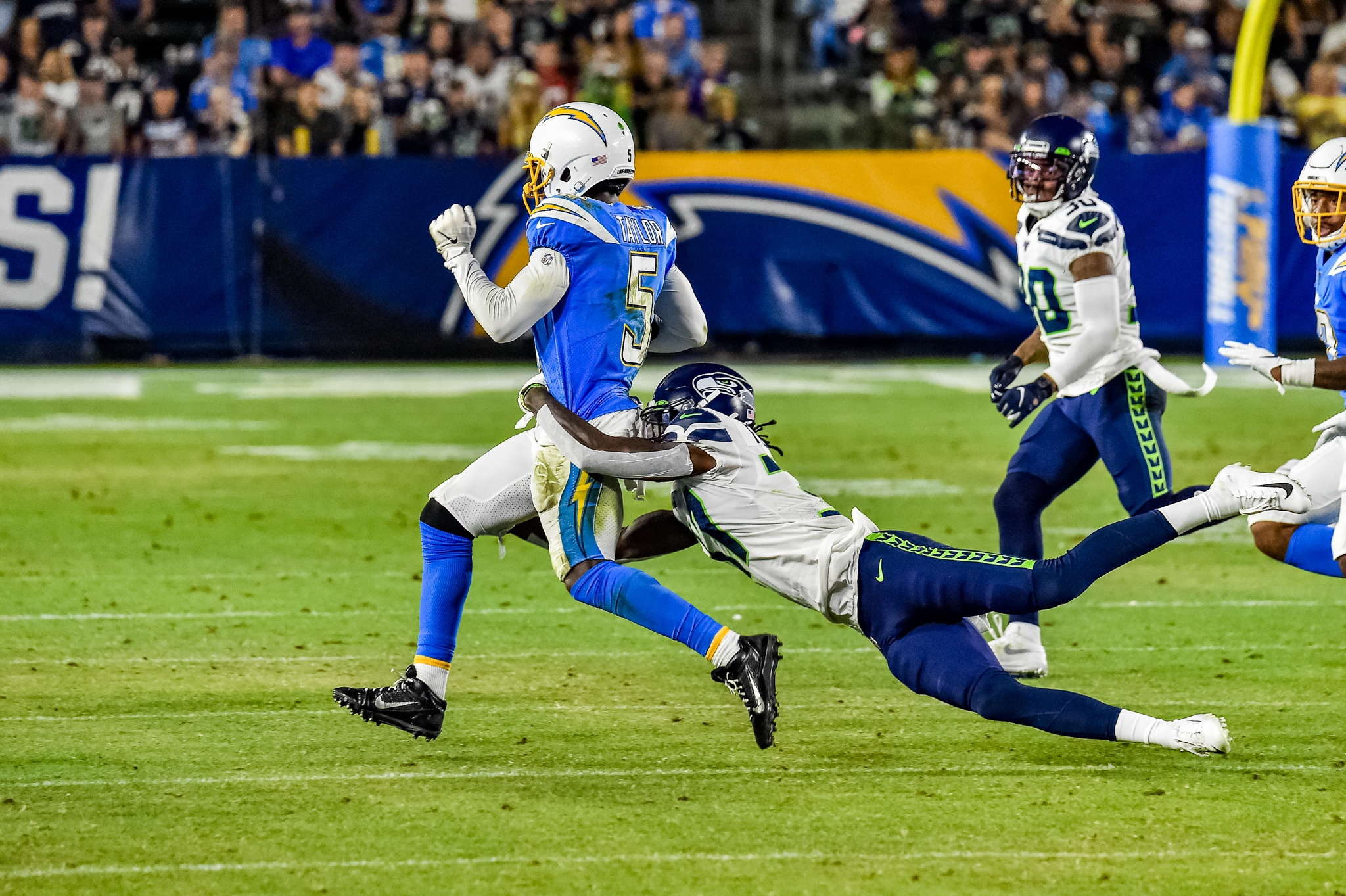 © Mark Hammond/News4usonline - Aug. 24, 2019 - Seahawks vs. Chargers - Chargers quarterback Tyrod Taylor (5) gets dragged down by a Seattle Seahawks defender.