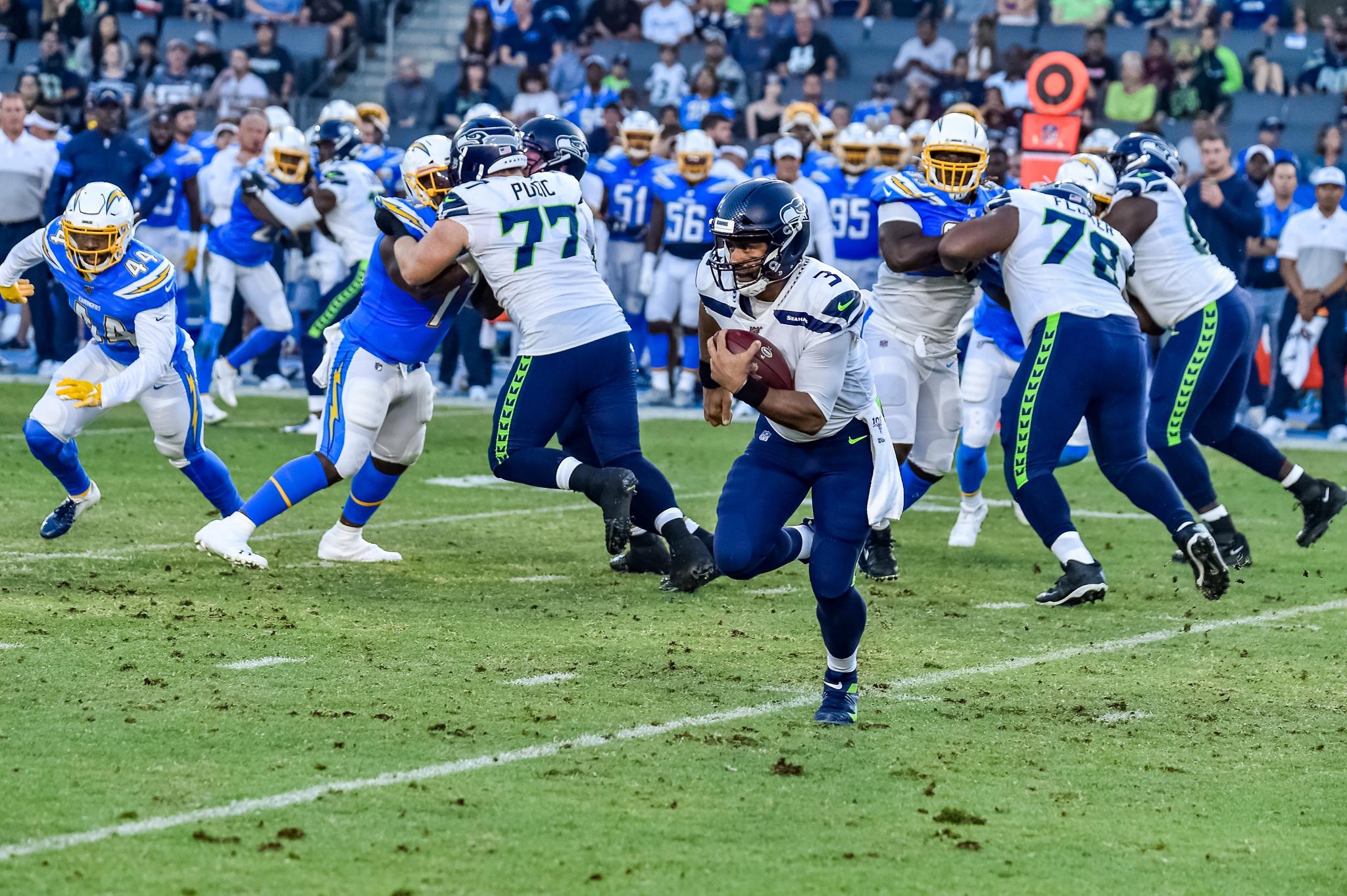© Mark Hammond/News4usonline - Aug. 24, 2019 - Seahawks vs. Chargers - Seattle Seahawks quarterback Russell Wilson on the run