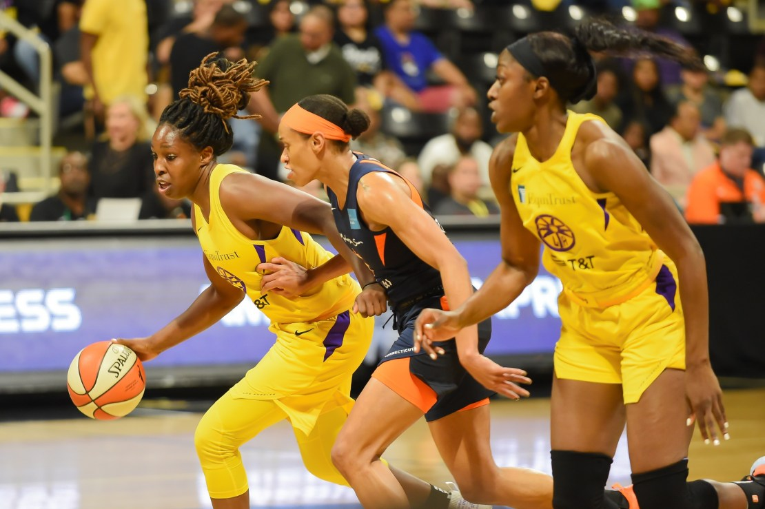 Sept. 22, 2019 Sept. 22, 2019 © Sammy Saludo/News4usonline - Los Angeles Sparks guard Chelsea Gray attempts to dribble the ball up the court against the defense of a Connecticut Sun player.