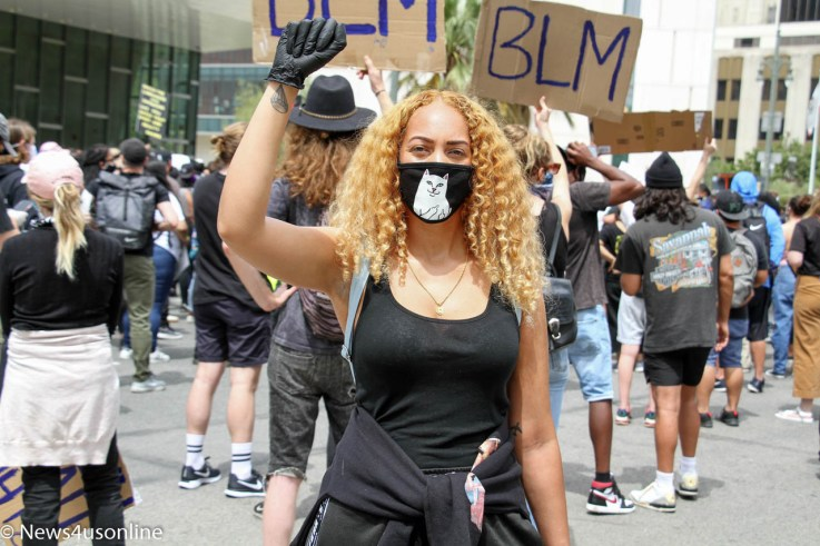 A protester lifts up a Black Power salute during a George Floyd demonstration on Tuesday, June 2, 2020, in downtown Los Angeles, California. Photo by Dennis J. Freeman