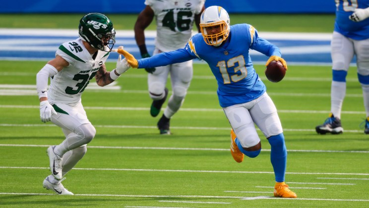 Los Angeles Chargers wide receiver Keenan Allen (13) staves off a New York Jets defender for yards after the catch. Allen caught 16 passes for 145 yards and a touchdown in the Chargers' 34-28 win over the Jets on Sunday, Nov. 22, 2020. Photo credit: Los Angeles Chargers