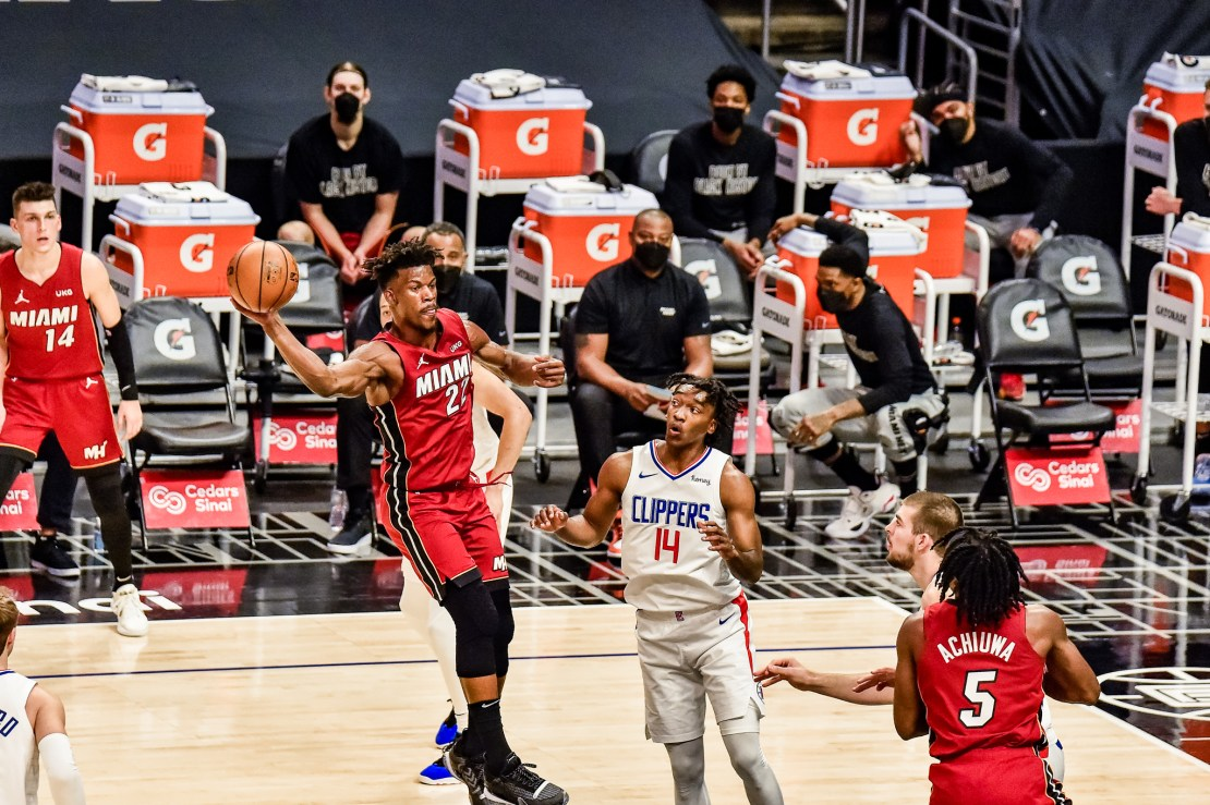 MIami Heat forward Jimmy Butler goes airborne against the Los Angeles Clippers in a game played at STAPLES Center on Monday, Feb. 15, 2021. Photo by Mark Hammond/News4usonline