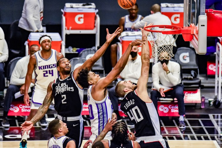 Los Angeles Clippers forward Kawhi Leonard (2) skies for the rebound in a game against the Sacramento Kings. Photo credit: Mark Hammond/News4usonline