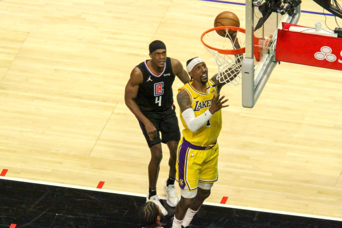 Los Angeles Clippers guard Rajon Rondo (4) watches Kentavious Caldwell-Pope score a layup during a May 6, 2021 matchup between the two teams. The Clippers defeated the Lakers, 118-94. Photo by Dennis J. Freeman/News4usonline