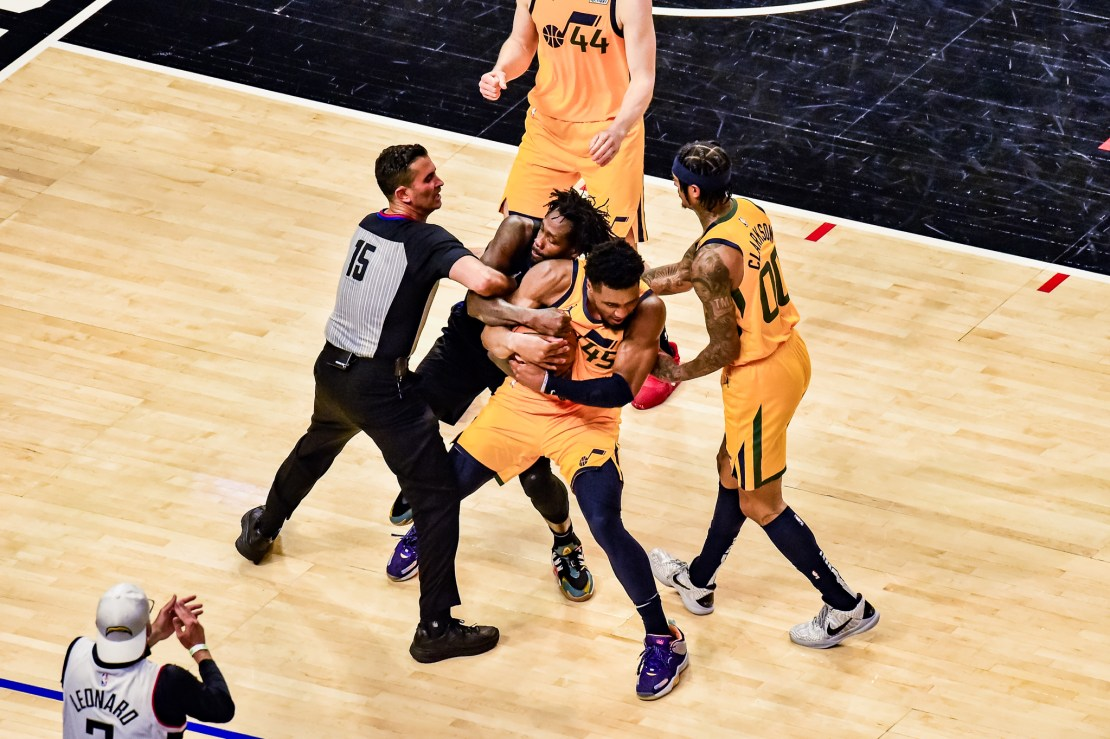 June 14, 2021-The intensity of playoff basketball is picked up in Game 4 of the Western Conference semifinal between the Los Angeles Clippers and Utah Jazz. Patrick Beverley of the Clippers and Donovan Mitchell (45) of the Jazz get into a wrestling match at STAPLES Center. Photo by Mark Hammond/News4usonline