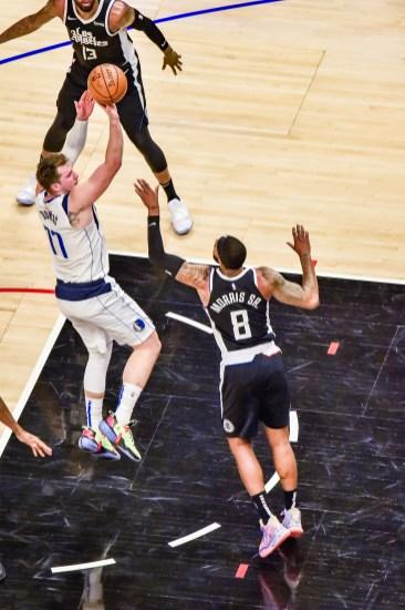 June 6, 2021-Luka Doncic (77) scores 46 points in Game 7. Photo credit: Mark Hammond/News4usonline