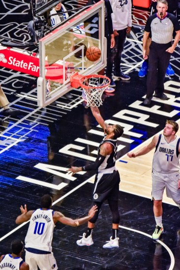 June 6, 2021-Paul George (13) goes for two points. Photo credit: Mark Hammond/News4usonline