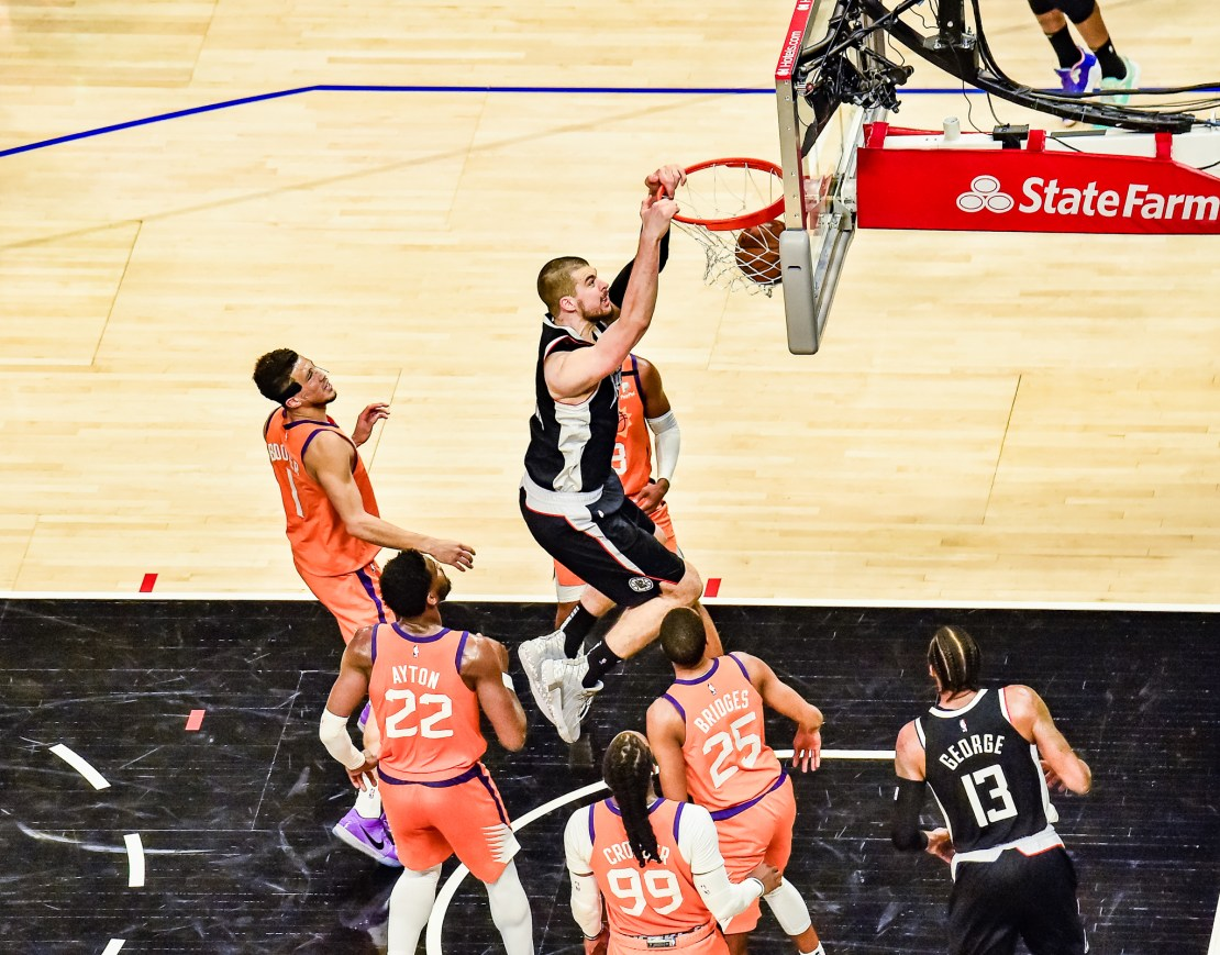 Clippers center Ivica Zubac slams the ball home for two points against the Phoenix Suns