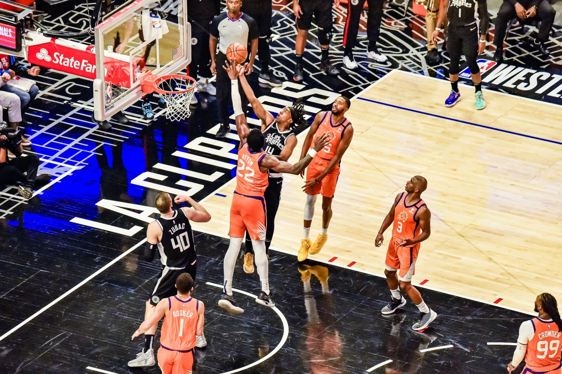 June 24, 2021-Los Angeles Clippers forward Terance Mann (14) goes for the layup against DeAndre Ayton of the Phoenix Suns in Game 4 of the Western Conference Finals. Photo credit: Mark Hammond/News4usonline