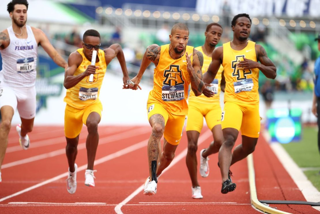 North Carolina A&T runner Trevor Steward takes the handoff in the men's 4x400 relay at the 21 NCAA Division I Men's and Women's Outdoor Track & Field Championship. 2021 NCAA Photos