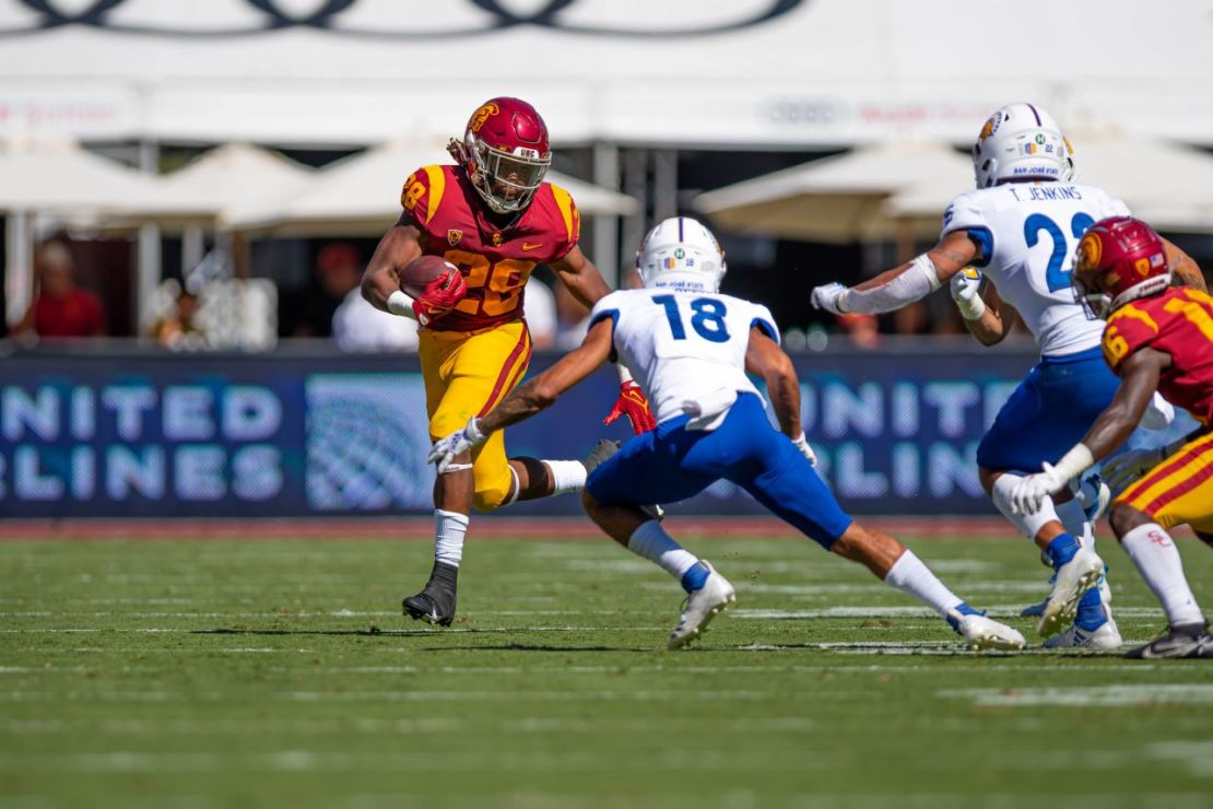 Sept. 4, 2021. USC running back Keaontay Ingram (28) runs by a San Jose State defender during the Trojans' 30-7 win at the Los Angeles Memorial Coliseum. Photo credit: Sammy Saludo/News4usonline
