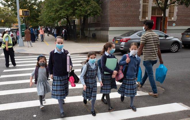 Coronavirus updates: Illinois Gov. Pritzker enters isolation; 300,000 NYC students return to classrooms despite rise in positive tests