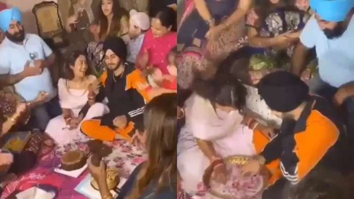 Neha Kakkar and Rohanpreet Singh receive grand welcome on beats of dhol, couple performs 'ring finding' ceremony
