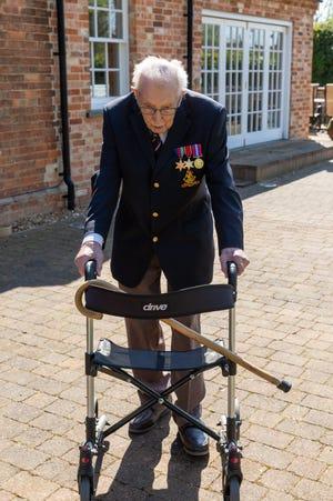Capt. Tom Moore, 'hero' UK veteran who raised millions by walking in his garden, dies at 100