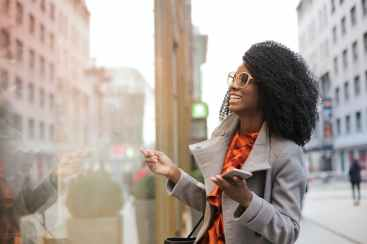 happy black woman laughing on street