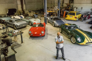 Chuck Beck's in his car garage