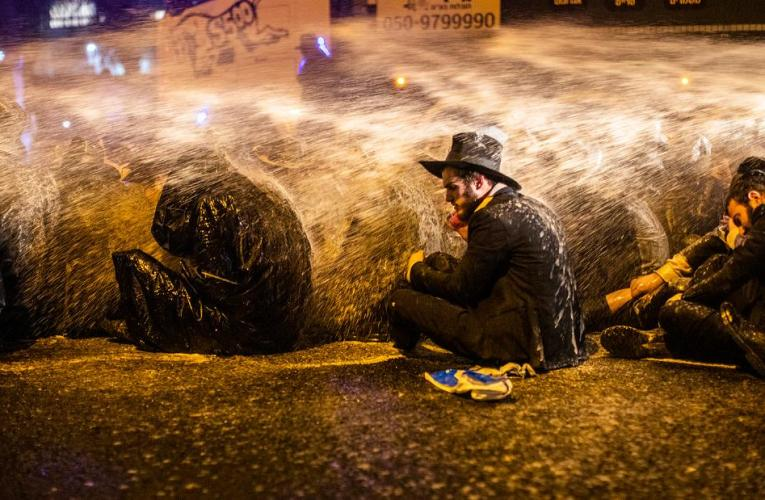 Violence and slurs from a few of Israel's ultra-Orthodox Jews in battle over coronavirus lockdowns