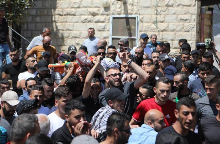 Palestinian shot dead in violent clashes as 12-year old, also killed by Israeli soldiers, is buried