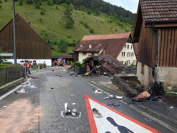 Parts of one of two planes which crashed during an air show are seen in the village of Dittingen, Switzerland in this handout photo provided by Kantonspolizei Basel Landschaft on August 23, 2015. Two small planes crashed at an air show in Dittingen, Switzerland, on Sunday, killing at least one person, police said. REUTERS/Kantonspolizei Basel Landschaft/Handout via Reuters ATTENTION EDITORS - FOR EDITORIAL USE ONLY. NOT FOR SALE FOR MARKETING OR ADVERTISING CAMPAIGNS. THIS IMAGE HAS BEEN SUPPLIED BY A THIRD PARTY. IT IS DISTRIBUTED, EXACTLY AS RECEIVED BY REUTERS, AS A SERVICE TO CLIENTS. REUTERS IS UNABLE TO INDEPENDENTLY VERIFY THE AUTHENTICITY, CONTENT, LOCATION OR DATE OF THIS IMAGE.