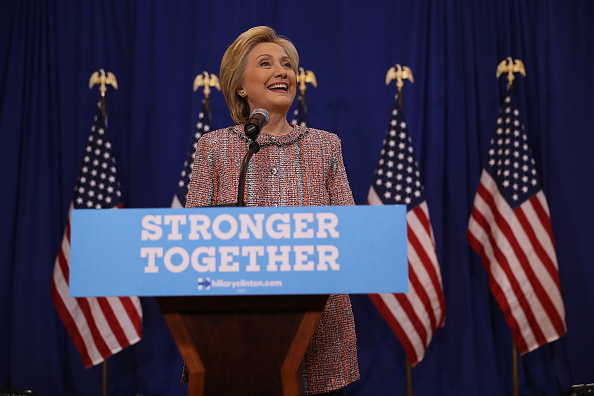 Hillary Clinton returns to campaign trail, releases medical report