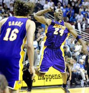 An ecstatic Kobe Bryant celebrates his 4th Championship Ring as the Los Angeles Lakers are NBA Champions again in 2009 15th time for the club and 10th for coaching great Phil Jackson